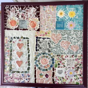 Kate's Mosaic table using flower heart inserts from MosaicInspiration.com
